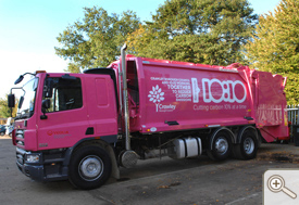 Pink rubbish truck with 10:10 design and joint messaging with Crawley Council